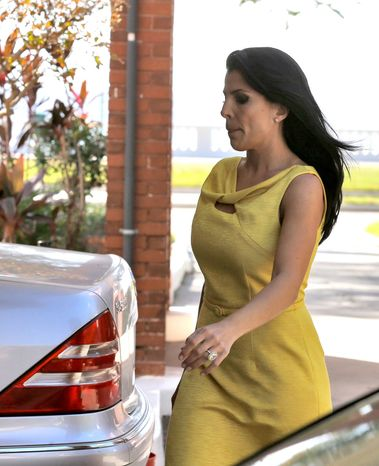 Jill Kelley leaves her home in Tampa, Fla., on Nov. 12, 2012. Kelley is identified as the woman who allegedly received harassing emails from Gen. David Petraeus' paramour, Paula Broadwell. She serves as an unpaid social liaison to MacDill Air Force Base in Tampa, where the military's Central Command and Special Operations Command are located. (Associated Press)