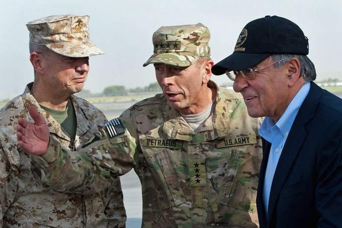 **FILE** Gen. John Allen (left), and Army Gen. David Petraeus (center), top U.S. commander in Afghanistan and incoming CIA Director, greet former CIA Director and new U.S. Defense Secretary Leon Panetta as he lands in Kabul, Afghanistan, on July 9, 2011. (Associated Press)