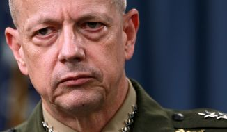 **FILE** Marine Gen. John Allen, the top U.S. commander in Afghanistan, listens during a March 26, 2012, news conference at the Pentagon in Washington. (Associated Press)
