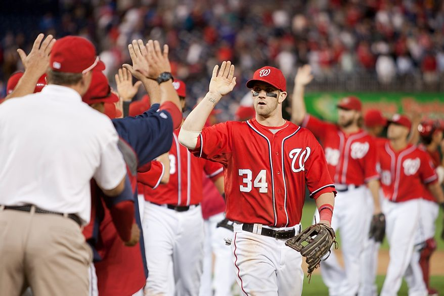 Washington Nationals center fielder Bryce Harper (34) celebrates after beating the Los Angeles Dodgers in the first game of a doubleheader at National Park,Wednesday, Sept. 19, 2012, in Washington, DC. Washington Nationals won 3-1 (Craig Bisacre/The Washington Times)