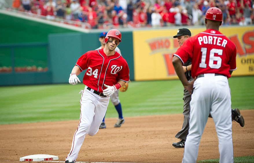 Washington Nationals Bryce Harper makes his way around third base after his solo home run in the bottom of the fifth inning as the Washington Nationals host the New York Mets at Nationals Park in Washington, D.C., Sunday, August 19, 2012. The Nationals defeated the Mets 5-2. (Rod Lamkey Jr./The Washington Times)