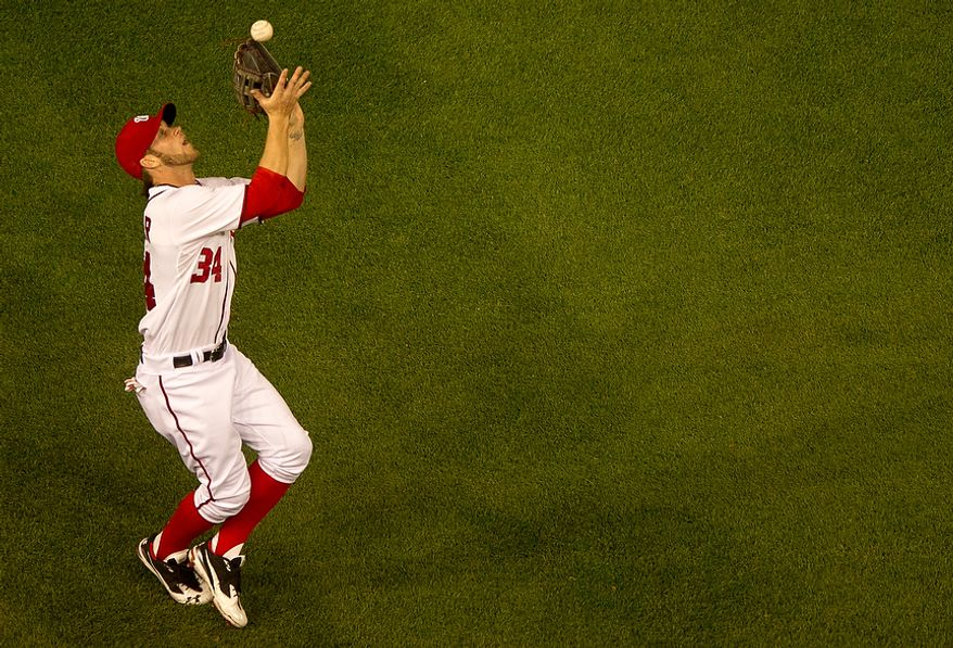 Washington Nationals right fielder Bryce Harper (34) catches a fly ball in left field as the Washington Nationals lose to the Arizona Diamondbacks 5-1 in Major League Baseball at Nations Ballpark, Washington, D.C., Tuesday, May 1, 2012. (Andrew Harnik/The Washington Times)