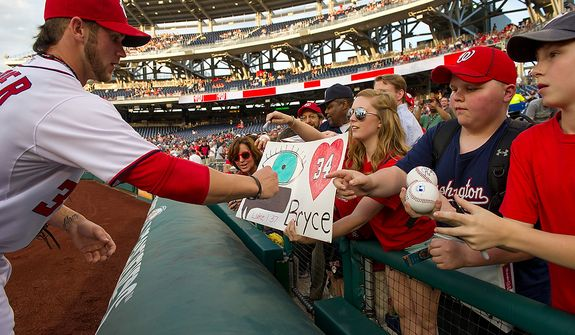 Bryce Harper signs autographs before the Washington Nationals take on the Arizona Diamondbacks in Major League Baseball at Nations Ballpark, Washington, D.C., Tuesday, May 1, 2012. (Andrew Harnik/The Washington Times)