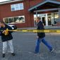 **FILE** Federal agents investigate the offices of New England Compounding Center in Framingham, Mass., on Oct. 16, 2012. The company's steroid medication has been linked to a deadly meningitis outbreak. (Associated Press/The Boston Globe, Barry Chin)