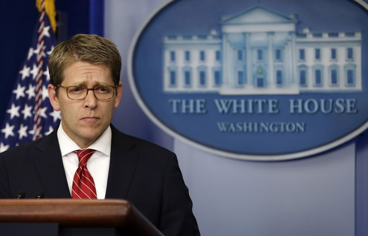 **FILE** White House spokesman Jay Carney pauses Nov. 13, 2012, during the daily news briefing at the White House in Washington. (Associated Press)