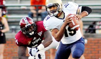 Keenan Reynolds lost a fumble that proved crucial in Saturday's 41-31 loss to Troy, but the freshman quarterback did rush for three touchdowns. (The Troy Messanger via Associated Press)