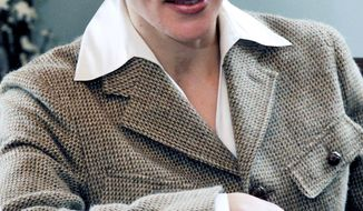 """Paula Broadwell, who ended up with more than a professional relationship with David H. Petraeus, conducted extensive interviews with critics and supporters for her book. """"All In,"""" however, has been described as """"part hagiography and part defense"""" of Mr. Petraeus' strategy in Iraq and Afghanistan. (Associated Press)"""