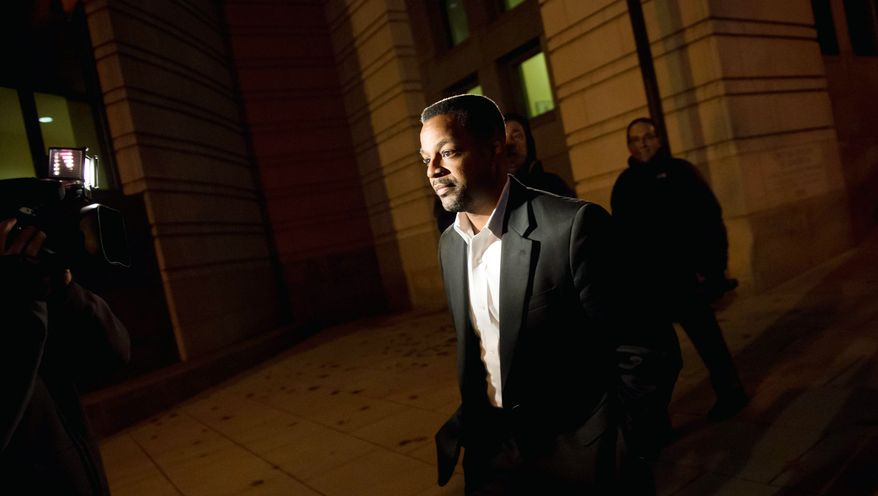 Former D.C. Council Chairman Kwame Brown leaves federal court in Washington on Tuesday after being sentenced to one day in custody and six months of home detention for lying on loan applications. (Andrew Harnik/The Washington Times)