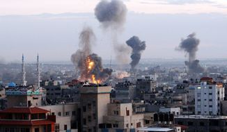 """Columns of smoke rise in Gaza City from a series of airstrikes that Israeli Prime Minister Benjamin Netanyahu calls a clear message to Hamas and other terrorist organizations."""" Hamas security officials said two of the organization's training facilities were among the 20 sites hit. (Associated Press)"""