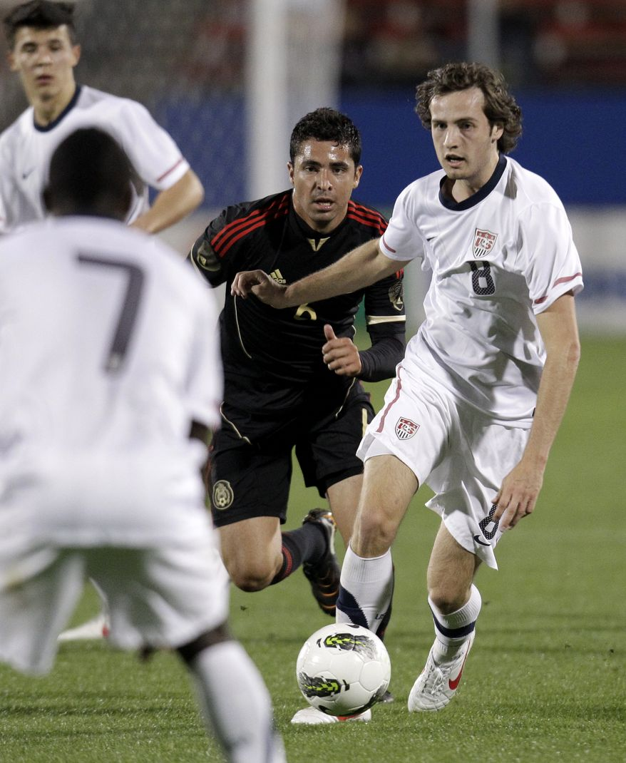U.S. midfielder Mix Ediskerud (8) of Norway prepares to pass the ball to Freddy Adu (7) as Mexico midfielder Ricardo Bocanegra (6) gives chase in the first half of an under-23 international friendly soccer match at FC Dallas Stadium Wednesday, Feb. 29, 2012, in Frisco, Texas. Diskerud had a goal and an assist within a two-minute span in the first half to lead the Americans in the 2-0 win. (AP Photo/Tony Gutierrez)