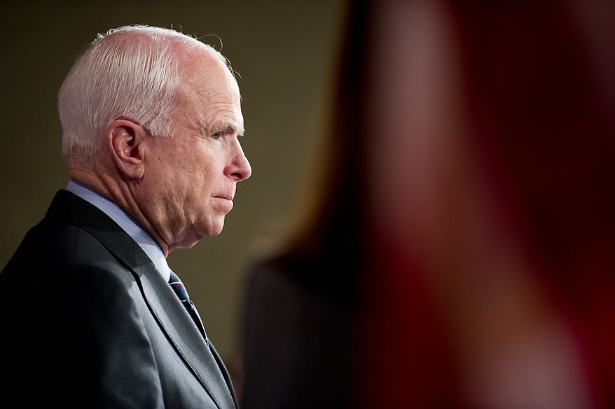 Sens. John McCain (R-Ariz.), pictured, listens as Lindsey Graham (R-S.C.)speaks at a press conference at the U.S. Capitol Building calling for a Senate Armed Services Committee Hearing on the Benghazi attack, Washington, D.C., Wednesday, November 14, 2012. (Andrew Harnik/The Washington Times)