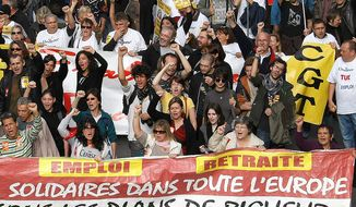 "Workers shout slogans and hold a banner reading "" Employment, pensions, united across Europe"" , during a demonstration against austerity, in Marseille, southern France,  Wednesday, Nov. 14, 2012.  With rampant unemployment spreading misery in southern Europe and companies shutting factories across the continent, workers around the European Union sought to unite in a string of strikes and demonstrations on Wednesday, with strikes and protests planned in Italy, Greece, Portugal, France and Belgium. (AP Photo/Claude Paris)"