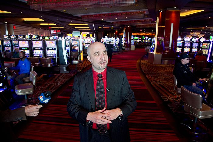 Robert Norton, general manager of Maryland Live! Casino in Hanover, Md., walks the media through the casino on Wednesday, Nov. 14, 2012 to indicate where the new live table games will be added. The casino plans to bring in some 150 table games, including Black Jack, Roulette, Craps, Sic Bo and Baccarat. Some of the electronic versions of these games will remain in the casino, but others will be removed. They are hoping to have them installed by spring. (Barbara L. Salisbury/The Washington Times)