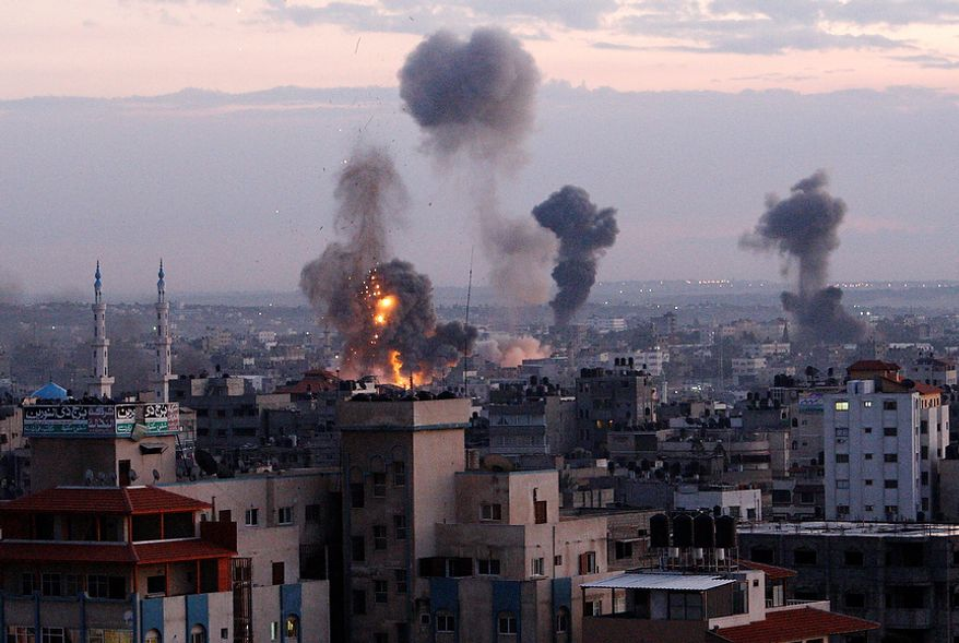 Columns of smoke rise following an Israeli air strike in Gaza City, Wednesday, Nov. 14, 2012. Palestinian witnesses say Israeli airstrikes have hit a series of targets across Gaza City, shortly after the assassination of the top Hamas commander. Hamas security officials say two Hamas training facilities were among the targets in the Wednesday afternoon bombings. (AP Photo/Adel Hana)