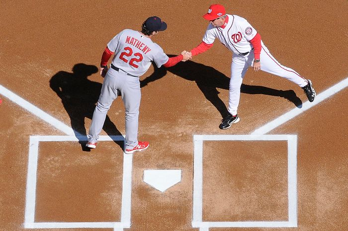 St. Louis Cardinals manager Mike Matheny (22) and Washington Nationals manager Davey Johnson shake hands at home plate before Game 3 of the National League Division Series at Nationals Park in Washington on Oct. 10, 2012. (Preston Keres/Special to The Washington Times)