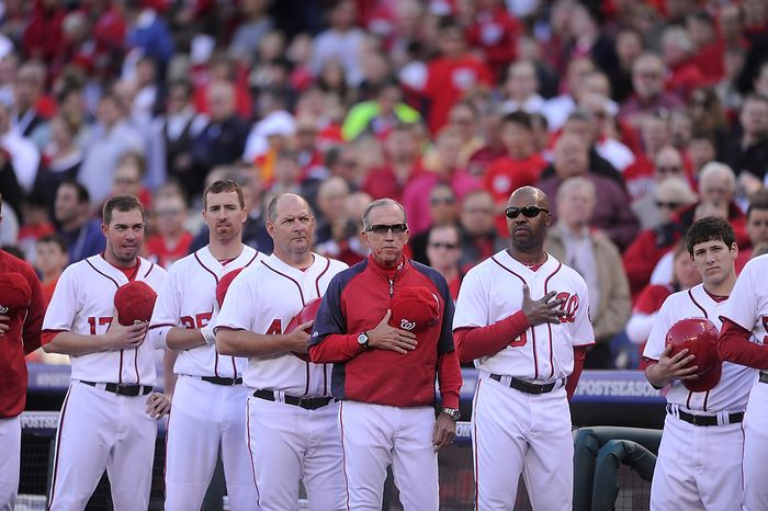 **FILE** Washington Nationals manager Davey Johnson (in red) joins the team in listening Oct. 11, 2012, to the National Anthem before Game 4 of the National League Division Series between the Nationals and St. Louis Cardinals at Nationals Park. (Preston Keres/Special to The Washington Times)