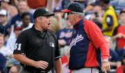 Washington Nationals manager Davey Johnson (right) argues with first base umpire Marvin Hudson before being ejected during the sixth inning of the Nationals' 5-4 road loss to the Atlanta Braves on Sept. 15, 2012. (Associated Press) **FILE**
