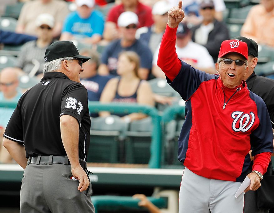 Washington Nationals manager Davey Johnson (right) gestures March 6, 2012, while talking to umpire Larry Vanover during a spring training game between the Nationals and Atlanta Braves in Lake Buena Vista, Fla. The Nationals won, 5-2. (Associated Press)