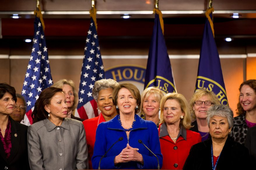 House Minority Leader Nancy Pelosi (center), California Democrat, surrounded by House congresswomen, announces that she will stay on as House minority leader at the U.S. Capitol Building, Washington, D.C., Wednesday, Nov. 14, 2012. (Andrew Harnik/The Washington Times)