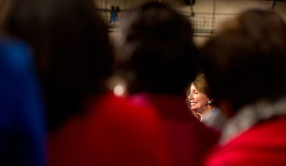 House congresswomen surround House Minority Leader Nancy Pelosi (D-Calif.), pictured, as she announces that she will stay on as House minority leader at the U.S. Capitol Building, Washington, D.C., Wednesday, November 14, 2012. (Andrew Harnik/The Washington Times)
