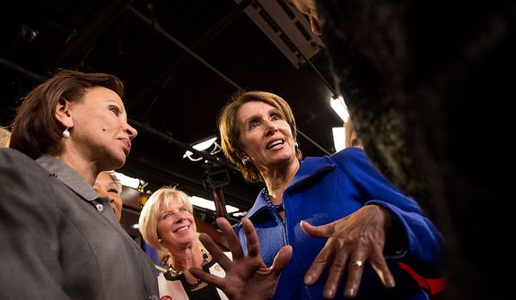 House Minority Leader Nancy Pelosi (D-Calif.), is congratulated by House congresswomen, as she announces that she will stay on as House minority leader at the U.S. Capitol Building, Washington, D.C., Wednesday, November 14, 2012. (Andrew Harnik/The Washington Times)