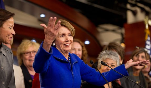 House Minority Leader Nancy Pelosi (D-Calif.), left, surrounded by House congresswomen, announces that she will stay on as House minority leader at the U.S. Capitol Building, Washington, D.C., Wednesday, November 14, 2012. (Andrew Harnik/The Washington Times)