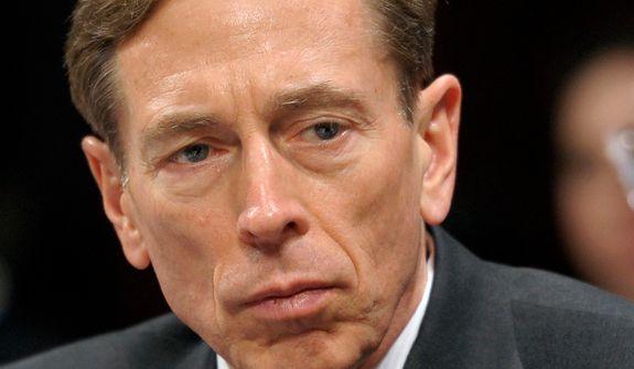 ** FILE ** This Feb. 2, 2012, file photo shows then-CIA Director David Petraeus testifying on Capitol Hill in Washington. Petraeus has resigned because of an extramarital affair.  (AP Photo/Cliff Owen, File)