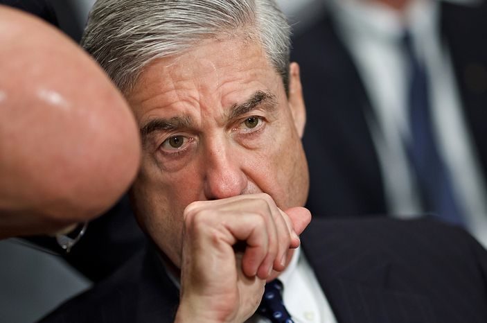 """**FILE** FBI Director Robert Mueller confers with an aide on Capitol Hill in Washington on May 16, 2012, prior to testifying before the Senate Judiciary Committee hearing: """"Oversight of the Federal Bureau of Investigation.""""  (Associated Press)"""
