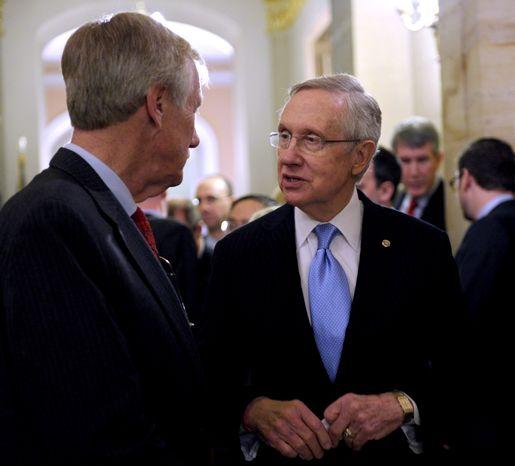 Senate Majority Leader Harry Reid (right), Nevada Democrat, talks Nov. 14, 2012, on Capitol Hill in Washington with Independent Sen.-elect Angus King of Maine. (Associated Press)
