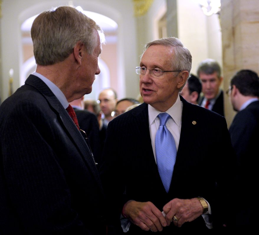 Senate Majority Leader Harry Reid (right), Nevada Democrat, talks Nov. 14, 2012, on Capitol Hill in Washington with Independent Sen.-elect Angus King of Maine. (Associated Press)