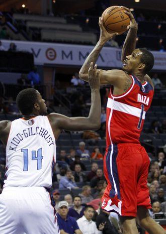Washington Wizards' Trevor Ariza (1) shoots over Charlotte Bobcats' Michael Kidd-Gilchrist (14) during the second half of an NBA basketball game in Charlotte, N.C., Tuesday, Nov. 13, 2012. Charlotte won 92-76. (AP Photo/Chuck Burton)
