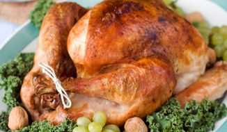 Make the centerpiece of your Thanksgiving meal easy and tasty by roasting the holiday turkey with savory vegetables and a coating of butter. (Associated Press)