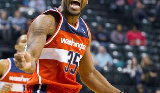 Forward Trevor Booker is averaging 8.1 points and 5.0 rebounds in the Wizards' 0-7 start. (Associated Press)