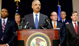 U.S. Attorney General Eric H. Holder Jr. is joined at a news conference in New Orleans about the BP oil spill settlement by Acting Associate Attorney General Tony West (far left) and Assistant Attorney General Lanny A. Breuer (second from right). BP agreed to plead guilty to felony manslaughter, environmental crimes and obstruction of Congress and to pay $4 billion in fines and penalties. (Associated Press)