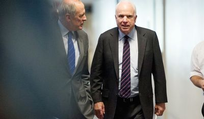 Republican Sens. Daniel Coats of Indiana (left) and John McCain of Arizona arrive for Thursday's closed-door intelligence committee hearing. (Andrew Harnik/The Washington Times)