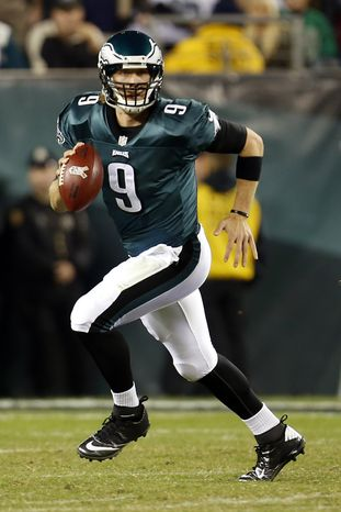 Philadelphia Eagles quarterback Nick Foles runs with the ball in the second half of an NFL football game against the Dallas Cowboys, Sunday, Nov. 11, 2012, in Philadelphia. (AP Photo/Julio Cortez)