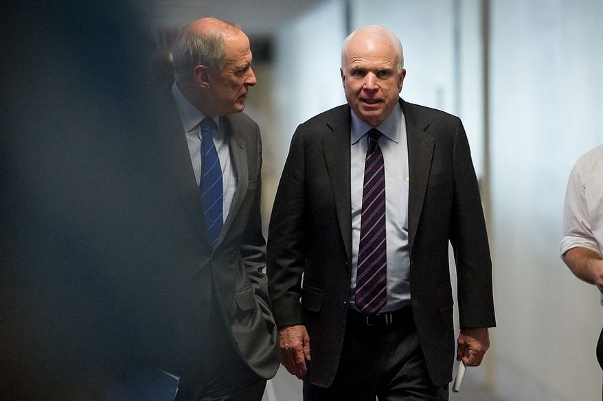Sens. Dan Coats (R-Ind.), left, and John McCain (R-Ariz.), right, arrive for a closed door Senate Select Committee on Intelligence hearing to discuss the September 11, 2012 attack on the U.S. Consulate in Benghazi, Libya, and the intelligence and security situation in other Arab Spring countries at the Hart Senate Office Building, Washington, D.C., Thursday, November 15, 2012. (Andrew Harnik/The Washington Times)
