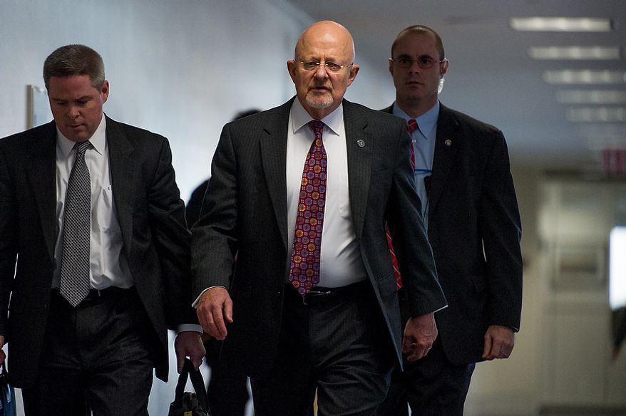 Director of National Intelligence James Clapper, center, arrives for a closed door Senate Select Committee on Intelligence hearing to discuss the September 11, 2012 attack on the U.S. Consulate in Benghazi, Libya, and the intelligence and security situation in other Arab Spring countries at the Hart Senate Office Building, Washington, D.C., Thursday, November 15, 2012. (Andrew Harnik/The Washington Times)