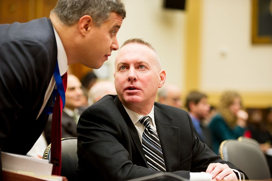 Government Accountability Office International Affairs and Trade Acting Director Michael Courts, right, speaks with an aid before testifying at a House Committee on Foreign Affairs hearing in the Rayburn Office Building on the September 11, 2012 attack on the american consulate in Benghazi, Washington, D.C., Thursday, November 15, 2012. (Andrew Harnik/The Washington Times)