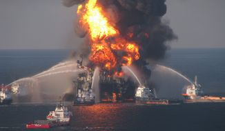 Fireboat response crews battle the blazing remnants of the offshore Deepwater Horizon on April 21, 2010. (AP Photo/U.S. Coast Guard)
