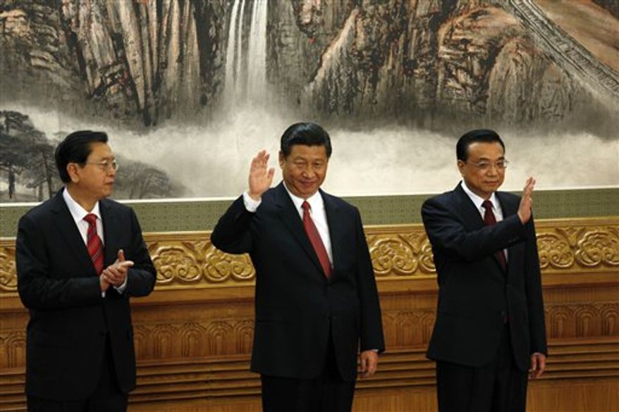 From left, members of the new Politburo Standing Committee Zhang Dejiang, Xi Jinping, Li Keqiang meet journalists in Beijing's Great Hall of the People Thursday, Nov. 15, 2012. The seven-member Standing Committee, the inner circle of Chinese political power, was paraded in front of assembled media on the first day following the end of the 18th Communist Party Congress. (AP Photo/Vincent Yu)