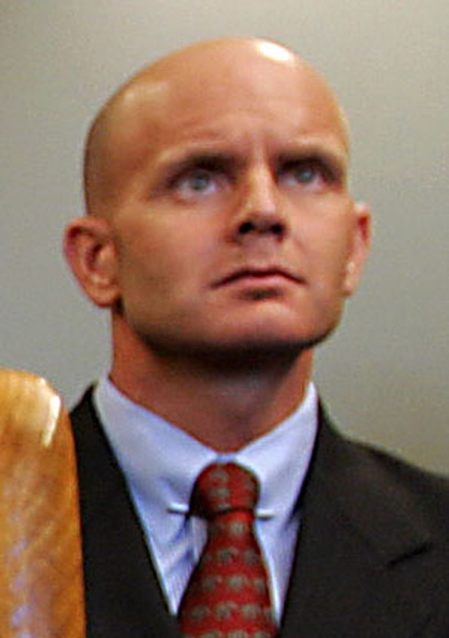 In this July 27, 2005, photo, FBI Agent Frederick Humphries listens during a news conference after the sentencing of Ahmed Ressam at the Federal Courthouse in Seattle. Humphries has been identified as the agent socialite Jill Kelley contacted to complain about harassing emails sent by Gen. David Petraeus' paramour, Paula Broadwell. (AP Photo/Kevin P. Casey)
