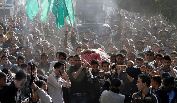 Palestinian mourners carry the body of Hamas' top military commander Ahmed Jabari, killed in an Israeli strike the previous day, during his funeral in Gaza City on Nov. 15, 2012. Israel barraged the Gaza Strip with airstrikes and shelling and killed the Hamas military chief in a targeted strike, launching a campaign aimed at stopping rocket attacks from Islamic militants. (Associated Press)