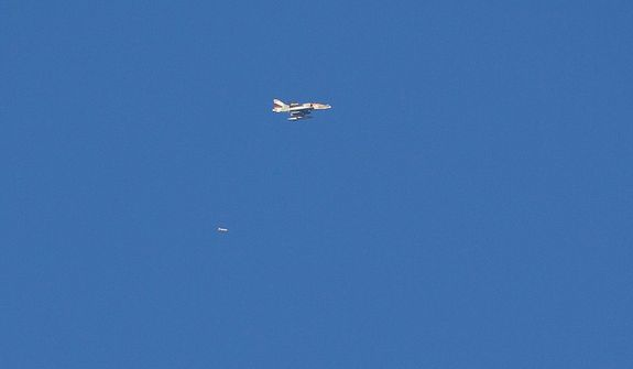 An Israel war plane drops a bomb over the northern Gaza Strip, seen from southern Israel near the Israel-Gaza border on Nov. 15, 2012. (Associated Press)
