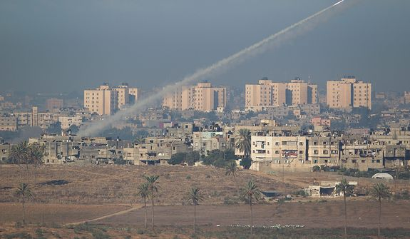 A rocket launched by Palestinians militants toward Israel makes its way from the northern Gaza Strip, seen from the Israel Gaza Border, southern Israel, on Nov. 15, 2012. (Associated Press)