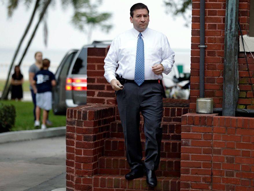 Dr. Scott Kelley, husband of Jill Kelley, leaves the family home Thursday, Nov 15, 2012, in Tampa, Fla. Jill Kelley is identified as the woman who allegedly received harassing emails from Gen. David Petraeus' paramour, Paula Broadwell. (AP Photo/Chris O'Meara)