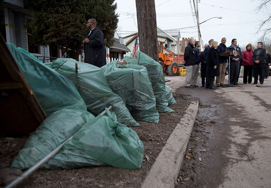 President Barack Obama talks to press on Cedar Grove Avenue, a street significantly impacted by Superstorm Sandy, Thursday, Nov. 15, 2012, on Staten Island, in New York. (AP Photo/Carolyn Kaster)