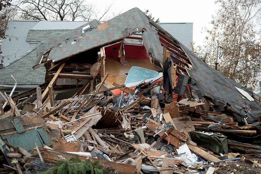 A home destroyed by Superstorm Sandy is seen on Cedar Grove Avenue on Staten Island, Thursday, Nov. 15, 2012 in New York., as President Barack Obama tours the area. (AP Photo/Carolyn Kaster)