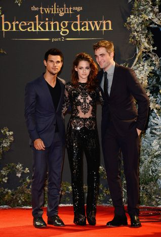 Actors Taylor Lautner, Kristen Stewart and Robert Pattinson are seen at The Twilight Saga: Breaking Dawn Part 2,  European Premiere at The Odeon Leicester Square on Wednesday Nov. 14, in London. (Photo by Jon Furniss/Invision/AP)