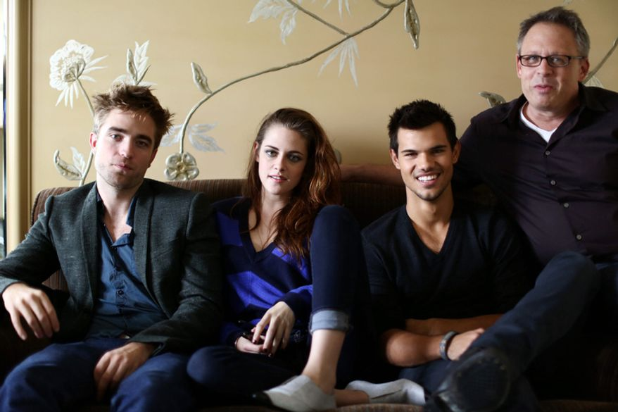 "In this Thursday, Nov. 1, 2012 photo, from left, actor Robert Pattinson, actress Kristen Stewart, actor Taylor Lautner, and director Bill Condon, from the upcoming film ""The Twilight Saga: Breaking Dawn Part 2,"" pose for a portrait in Los Angeles. ìTwilightî rocketed Stewart and Pattinson to superstardom, and their real-life romance only propelled them further. With the release on Friday, Nov. 16, 2012 of the final film in the franchise, ìThe Twilight Saga: Breaking Dawn Part 2,î the young actors bid farewell to the worldwide fantasy sensation.  (Photo by Matt Sayles/Invision/AP)"